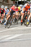 Male Cyclists Lean Into Turn In Amateur Bike Race Royalty Free Stock Photo