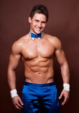 Male dancer. Muscled male model in blue dance suite Royalty Free Stock Photos