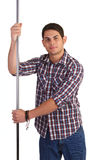 Male dancer. A male dancer about to perform a strip tease whilst dancing round a metal pole Royalty Free Stock Photography