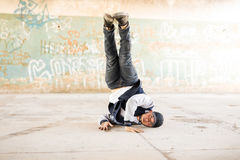 Male dancer doing a headstand Stock Image