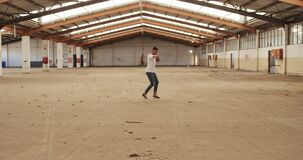 Male dancer in an empty warehouse
