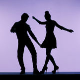Male dancer flirting with sexy woman Stock Photo
