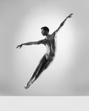 A male dancer flying on a grey background Royalty Free Stock Photo