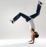 Male dancer freezes in a handstand Royalty Free Stock Images