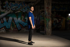 Male dancer in front of a graffiti wall Stock Photography