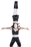 Male dancer with hidden face holds his partner Stock Photography