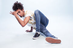 Male Dancer in a Hip Hop Pose on the Floor Royalty Free Stock Images