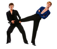 Male dancer holding leg of funny posing friend Royalty Free Stock Photography