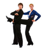 Male dancer holding leg of his funny friend Royalty Free Stock Image