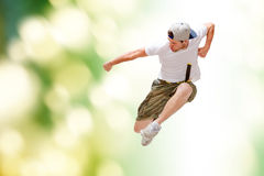 Male dancer jumping in the air. Dance and fitness concept - male dancer jumping in the air Stock Image