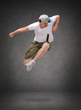 Male dancer jumping in the air. Dancing, happiness and people concept - male dancer jumping in the air Stock Images