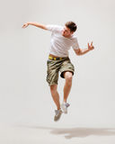 Male dancer jumping in the air Stock Photos