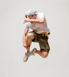 Male dancer jumping in the air. Picture of male dancer jumping in the air Royalty Free Stock Images