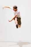 Male dancer jumping in the air. Sport and dancing concept - male dancer jumping in the air Stock Photography