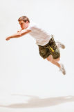 Male dancer jumping in the air. Sport and dancing concept - male dancer jumping in the air Stock Images