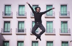 Male dancer performing jump in the air. Urban background Stock Image