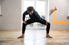 Male dancer stretching at gym Stock Photo