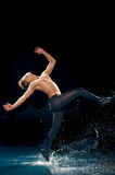 Male dancer under rain Royalty Free Stock Photography