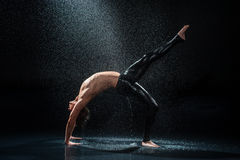 Male dancer under rain Royalty Free Stock Image