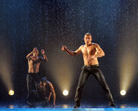 Male dancers in the rain Stock Photo