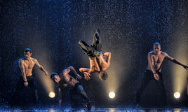 Male dancers in the rain stock photo