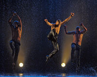Male dancers in the rain Stock Image