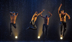 Male dancers in the rain. Performance of the St. Petersburg theater dance Temptation Royalty Free Stock Photo