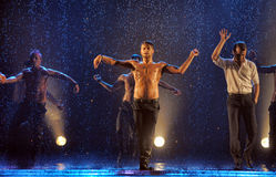 Male dancers in the rain Stock Photos