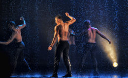 Male dancers in the rain Royalty Free Stock Image