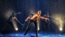 Male dancers in the rain Royalty Free Stock Photo