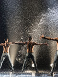Male dancers in the rain Royalty Free Stock Photos