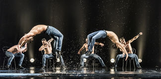 Male dancers in the rain stock photography