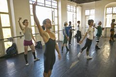 Male dancers stretching and exercising at Pro Danza Ballet dance studio and school , Cuba Stock Photo