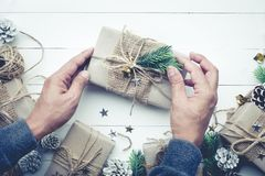 Male decorating christmas presents gift box.collection in vintage Royalty Free Stock Photos