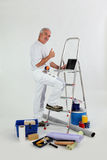 Male decorator. With ladder giving thumbs-up royalty free stock photo