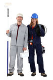 Male decorator female electrician. Male decorator standing female electrician Stock Photography