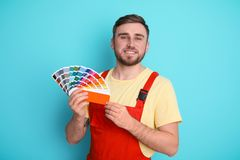 Male decorator with palette. On color background Royalty Free Stock Photography