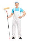 Male decorator posing with a paint roller Royalty Free Stock Image