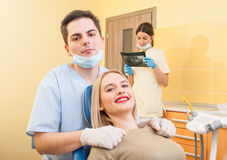 Male dentist doctor and happy patient Royalty Free Stock Images