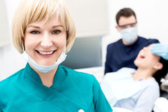 Male dentist doing teeth checkup behind Royalty Free Stock Photography