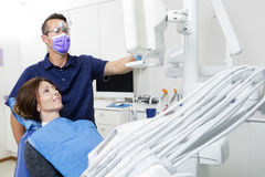 Male Dentist Explaining Xray To Female Patient In Clinic Royalty Free Stock Photography