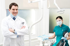 Male dentist with female assistant Royalty Free Stock Image