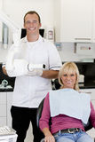 A male dentist with a female patient in his surgery Stock Photography