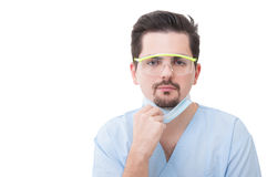 Male dentist holding his protective mask Royalty Free Stock Photo