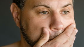 Male in depression. Close-up.on a dark background stock footage