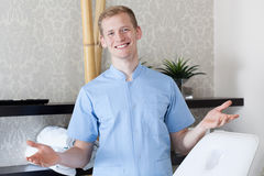 Male dermatologist showing welcome gesture stock photo