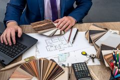 Male designer at office with wooden color swatches. House project Royalty Free Stock Photography