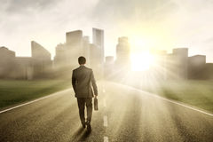 Male developer walking toward a city Royalty Free Stock Images