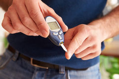 Male Diabetic Checking Blood Sugar Levels Royalty Free Stock Image