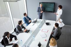 Director and female assistant hold business meeting in company royalty free stock image